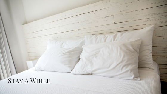 Shiplap headboard with white bedding and pillows