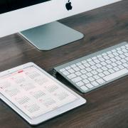 Apple desktop computer and 12 month calendar