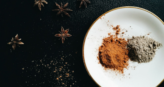 Star anise, ground cinnamon, and ground cardamom